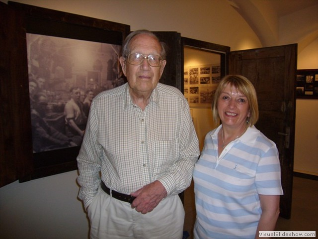 Eric & Jean Eastwood in front of William Eastwood's photo from 18A